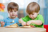 picture of kindergarten  - kids eating healthy food at home or kindergarten - JPG