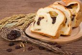 stock photo of home-made bread  - slice of home made raisin bread with died raisin - JPG