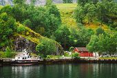 stock photo of fjord  - Docks in small tourist town of Flam on western side of Norway deep in fjords - JPG
