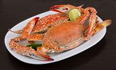 pic of cooked blue crab  - Boiled crabs with lime on the wood background - JPG