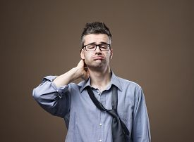 pic of confusing  - Confused untidy businessman with hand behind head unemployment and depression concept - JPG