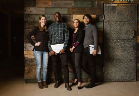 picture of coworkers  - Full length portrait of successful business team standing in an office - JPG
