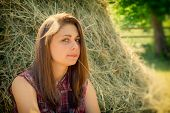 picture of haystack  - portrait of a pretty girl on the background of haystacks in the countryside - JPG