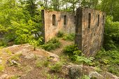 picture of crusher  - The remains of a quarry rock crusher in the woods - JPG