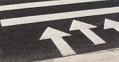 pic of pedestrians  - pedestrian crossing with arrows indicating the direction of in a modern city - JPG