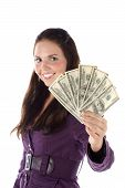 Smiling female with pile of dollar (focus on hand)