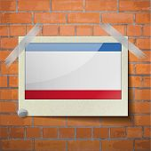 picture of crimea  - Flags of Crimea scotch taped to a red brick wall - JPG