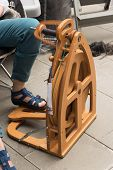 foto of spinner  - Wooden spinner machine for rolling the yarn  - JPG
