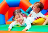pic of playground  - happy kids having fun on playground in kindergarten - JPG
