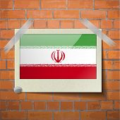 picture of tehran  - Flags of Iran scotch taped to a red brick wall - JPG