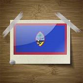 stock photo of guam  - Flags of Guam at frame on wooden texture - JPG