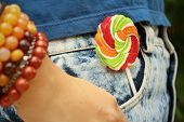 image of texans  - colorful of candy in a jeans pocket - JPG