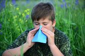 picture of excrement  - A teen boy with allergies in flowering herbs - JPG