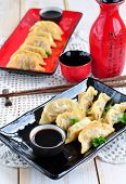 picture of soy sauce  - Fried asian wonton with soy sauce - JPG
