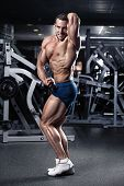picture of hamstring  - Strong Athletic Man Fitness Model Torso showing muscles in gym - JPG