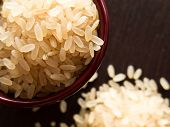 image of staples  - A small bowl of parboiled risotto rice an important food staple - JPG