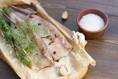 picture of squid  - Fresh squid carcass with spices on paper - JPG