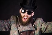 pic of queer  - Strangely elegant hipster man in an unusual outfit staring - JPG
