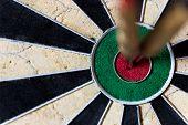picture of bullseye  - closeup of a Dartboard with Steeldarts in bullseye - JPG