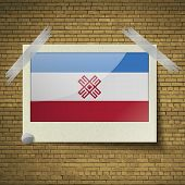 picture of mary  - Flags of Mari El at frame on a brick background - JPG