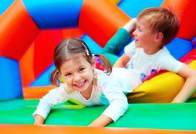 pic of daycare  - happy kids having fun on playground in kindergarten - JPG
