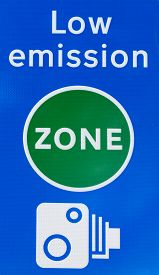 stock photo of traffic signal  - Close up detail of a signal indicating the limit of low emission traffic zone in London United Kingdom with camera tutor for violations and fines - JPG
