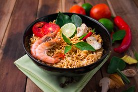stock photo of noodles  - Tom Yum Kung with noodles is popular Thai dish cuisine - JPG