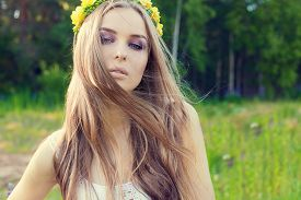 stock photo of wind-rose  - beautiful sexy sweet girl with long hair and a wreath of yellow roses on his head in the field - JPG