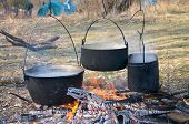 pic of boiling water  - boiled water in kettles above the fire - JPG