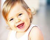 pic of baby toddler  - Small baby is laughing  - JPG
