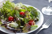 foto of mange-toute  - Close up image of healthy salad with table setting - JPG