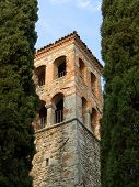 Bell Tower Between Cypresses poster