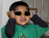 foto of rutin  - An young asian kid having fun with his goggles - JPG