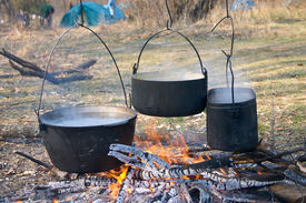 image of boiling water  - boiled water in kettles above the fire - JPG