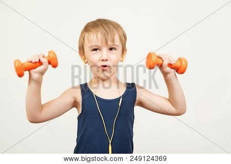 poster of Funny Kid With Dumbbells, Doing Exercising, Listen Music With Headphones. Happy Little Boy Do Exerci