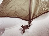 Detail Of Tent Anchorage On Snow. A Snow Storm Came Within  Night And Cover The  Landscape With Fres poster