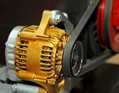 foto of dynamo  - Golden alternator for electric generator in vehicle - JPG