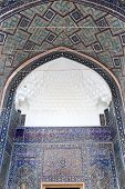 stock photo of mosk  - Decorated arch of Tilya Kori Madrasah from courtyard in Samarkand Uzbekistan - JPG