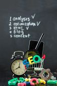 Seo Search Engine Optimization Concept Colored Letters Of Seo With Clock, Magnifying , Smartphone, G poster