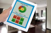 Household Electricity Consumption Control System Show On Digital Tablet In Someone Hand. poster