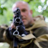 The Man Hunter Is Aiming At The Gun. Sighting The Gun Barrel At The Target. poster