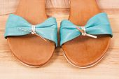 Pair Of Leather Sandals For Woman, Concept Of Footwear For Using On Holiday poster