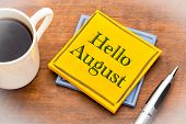 Hello August - text on a sticky note against rustic wood with a cup of coffee poster