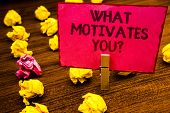 Conceptual Hand Writing Showing What Motivates You Question. Business Photo Showcasing Passion Drive poster