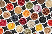 Health food for a healthy heart with vegetables, fruit, grains, pulses, nuts, seeds and medicinal he poster