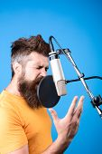 Bearded Man Singing Into Microphone. Music. Show Business. Recording Studio. Male Singer With Microp poster