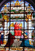 stock photo of he is risen  - A stained glass window featuring a red angel from an Anglican church in St - JPG