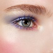 Beautiful Blue Eyes With Bright Creative Cosmetics. Long Eyebrows And Dense Eyelashes Create The Fas poster