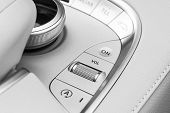 Media And Navigation Control Buttons Of A Modern Car. Car Interior Details. White Leather Interior O poster