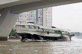 image of hydrofoil  - Hydrofoil boat under a bridge on Saigon River in Ho Chi Minh City Vietnam - JPG